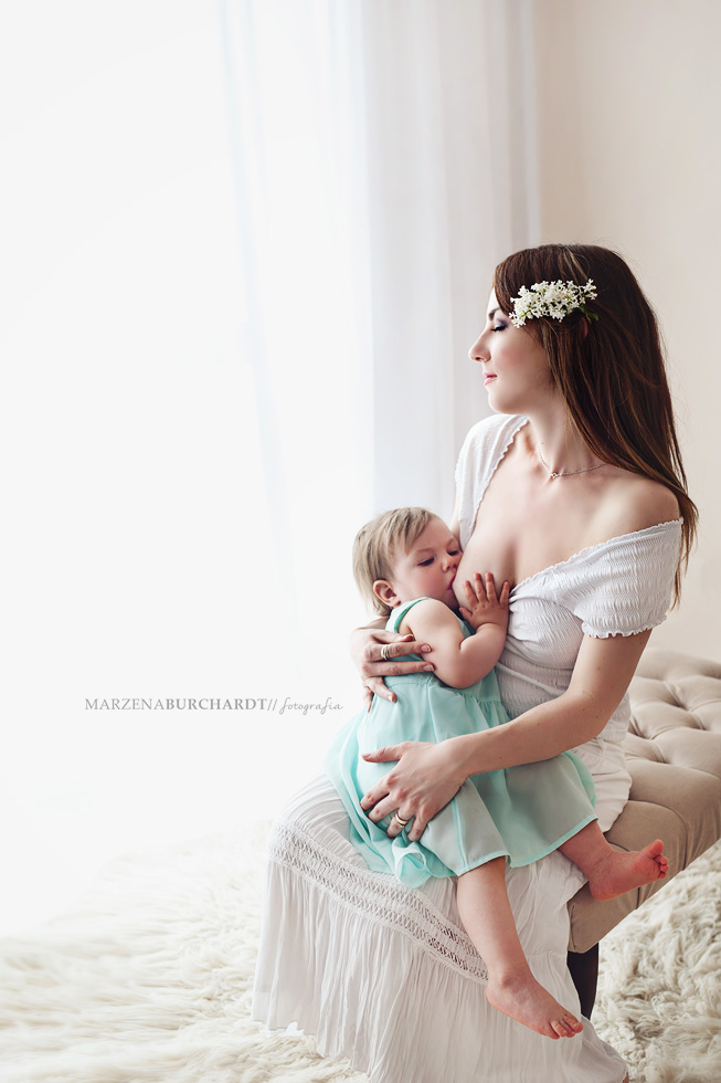 Young woman breastfeeding her baby outdoors
